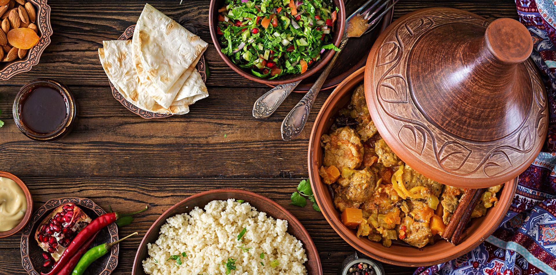 Africa Morocco traditional savory tagine dish with couscous fresh salad rich spices culture - luxury vacation destinations