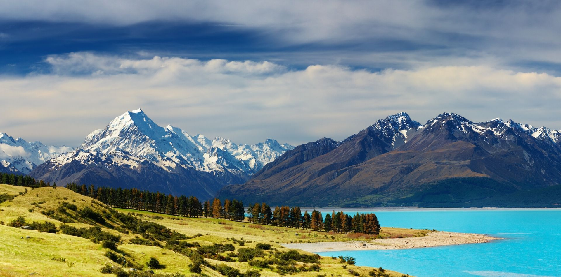 Oceania New Zealand Aoraki Mount Cook National Park with bright blue water - luxury vacation destinations