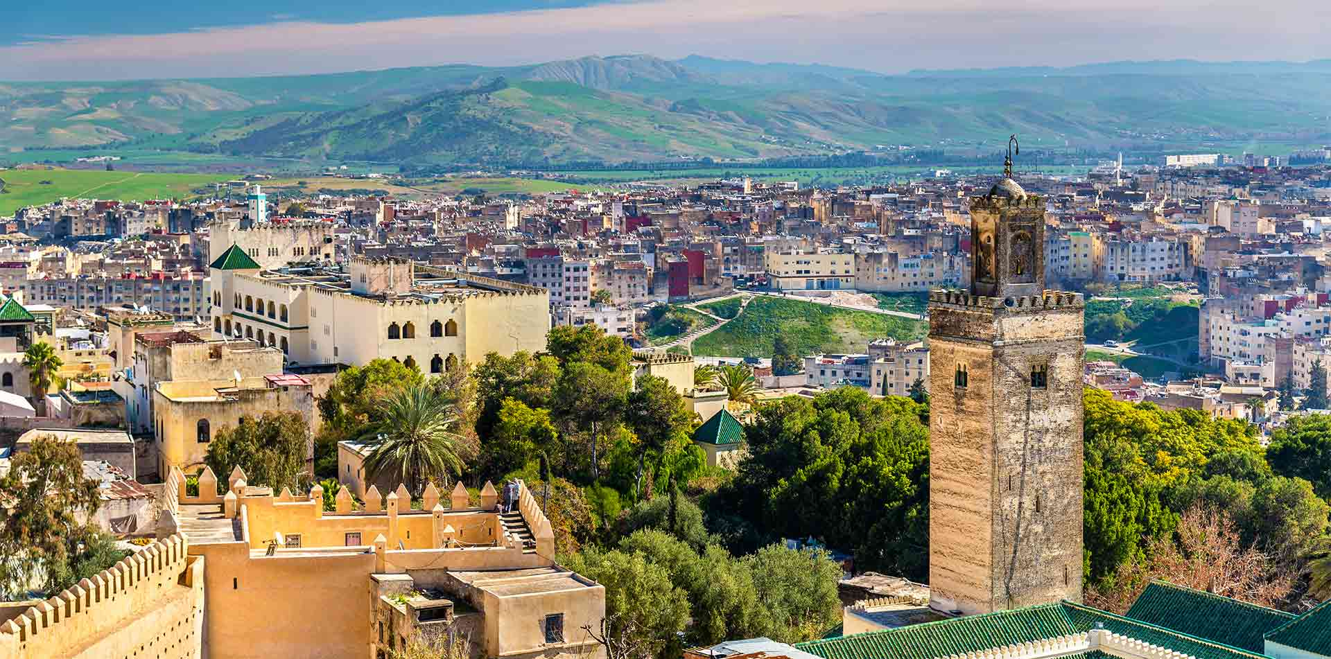 Africa Morocco Fes scenic walled city view of historic Bab Guissa Mosque and gate - luxury vacation destinations