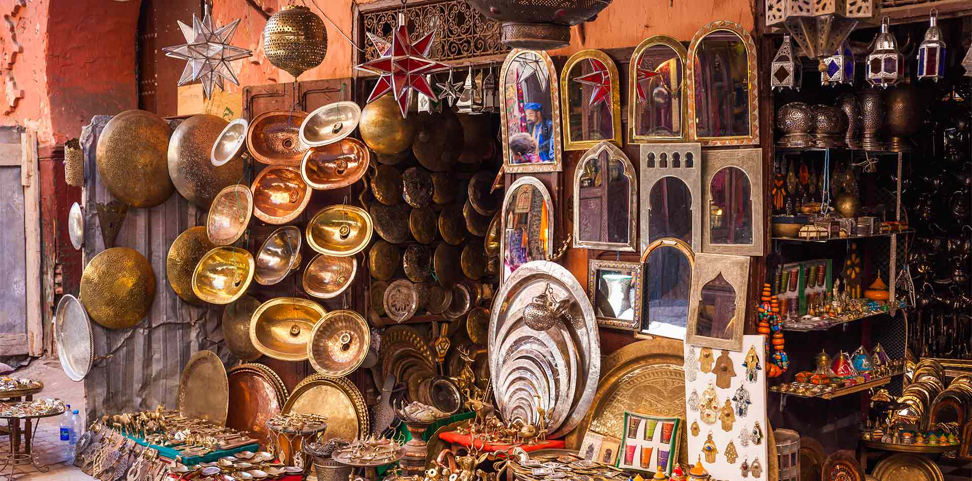 Africa Morocco Marrakesh ornate metalwork decorative souvenirs for sale in souk - luxury vacation destinations