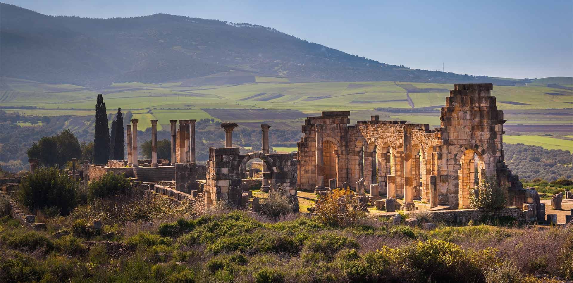 Africa Morocco Volubilis scenic archaeological site ancient basilica of Roman ruins - luxury vacation destinations