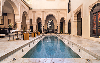 Africa Morocco Riad Fès beautiful relaxing pool Moorish style architecture - luxury vacation destinations