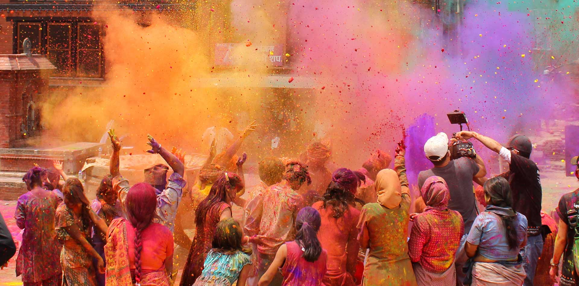 Asia India locals celebrating Holi Festival with colored powders - luxury vacation destinations