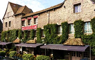 Europe France Normandy Honfleur historic Les Maisons de Léa charming ivy covered exterior - luxury vacation destinations