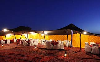 Africa Morocco Sahara Desert Merzouga Madu Berber encampment dining tents at night culture - luxury vacation destinations