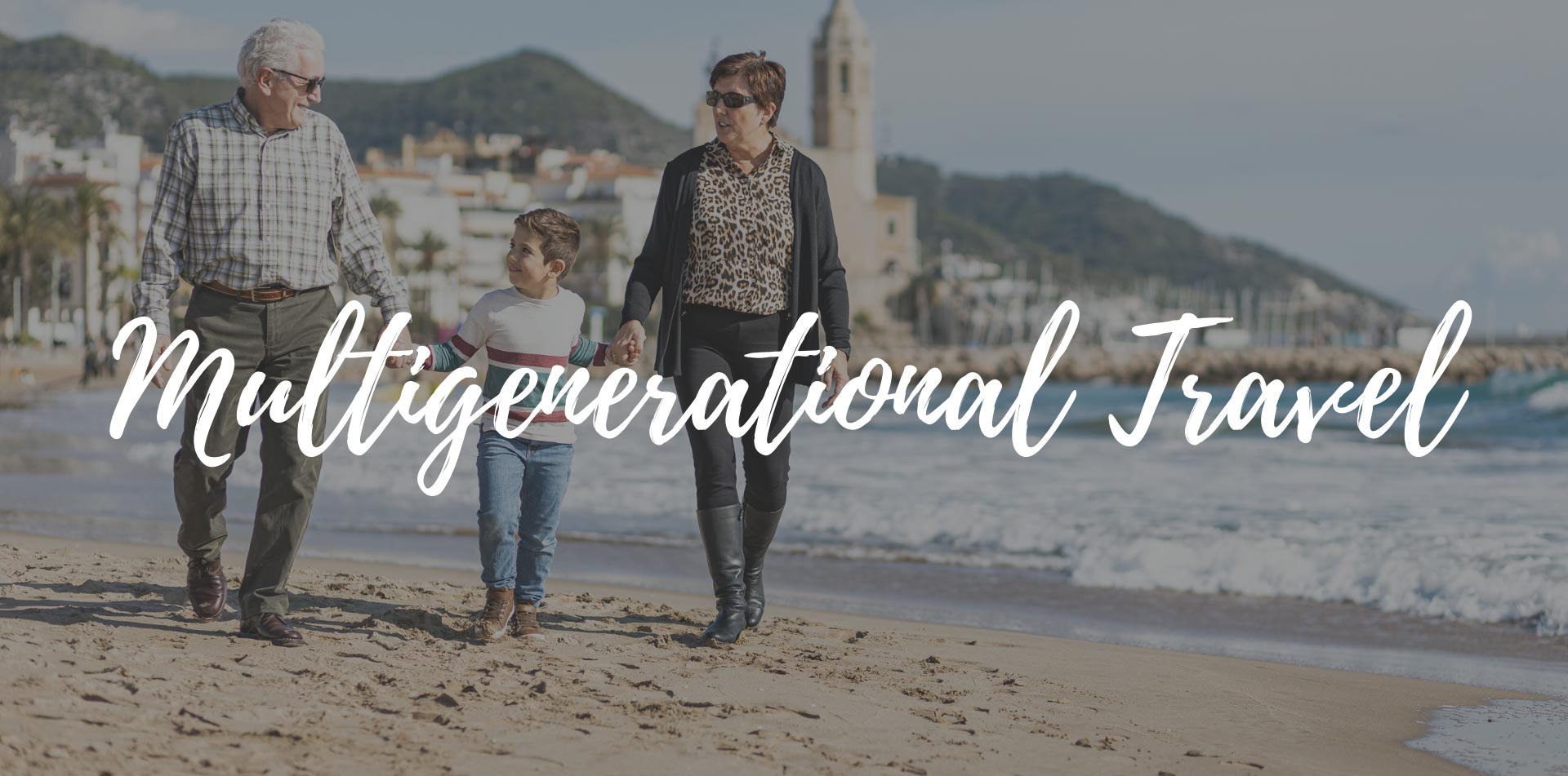 Europe Spain grandparents and grandson holding hands walking on the beach - luxury vacation destinations