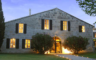 Europe France Provence Arles Le Mas de Peint hotel stone farmhouse at night - luxury vacation destinations