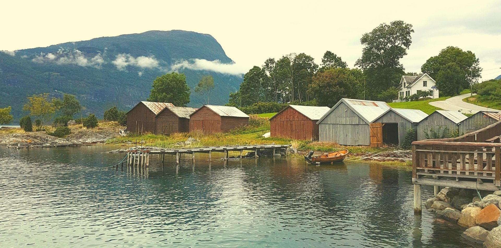 Europe Norway beautiful lakeside huts in local fishing village - luxury vacation destinations