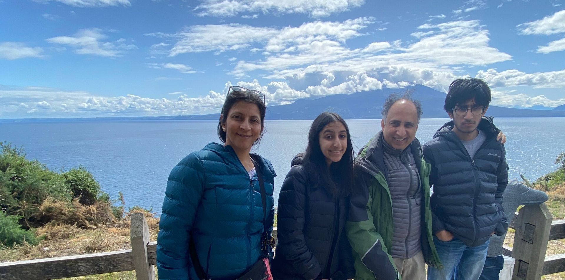Traveling family on a walking path in Chile along the water - luxury vacation destinations