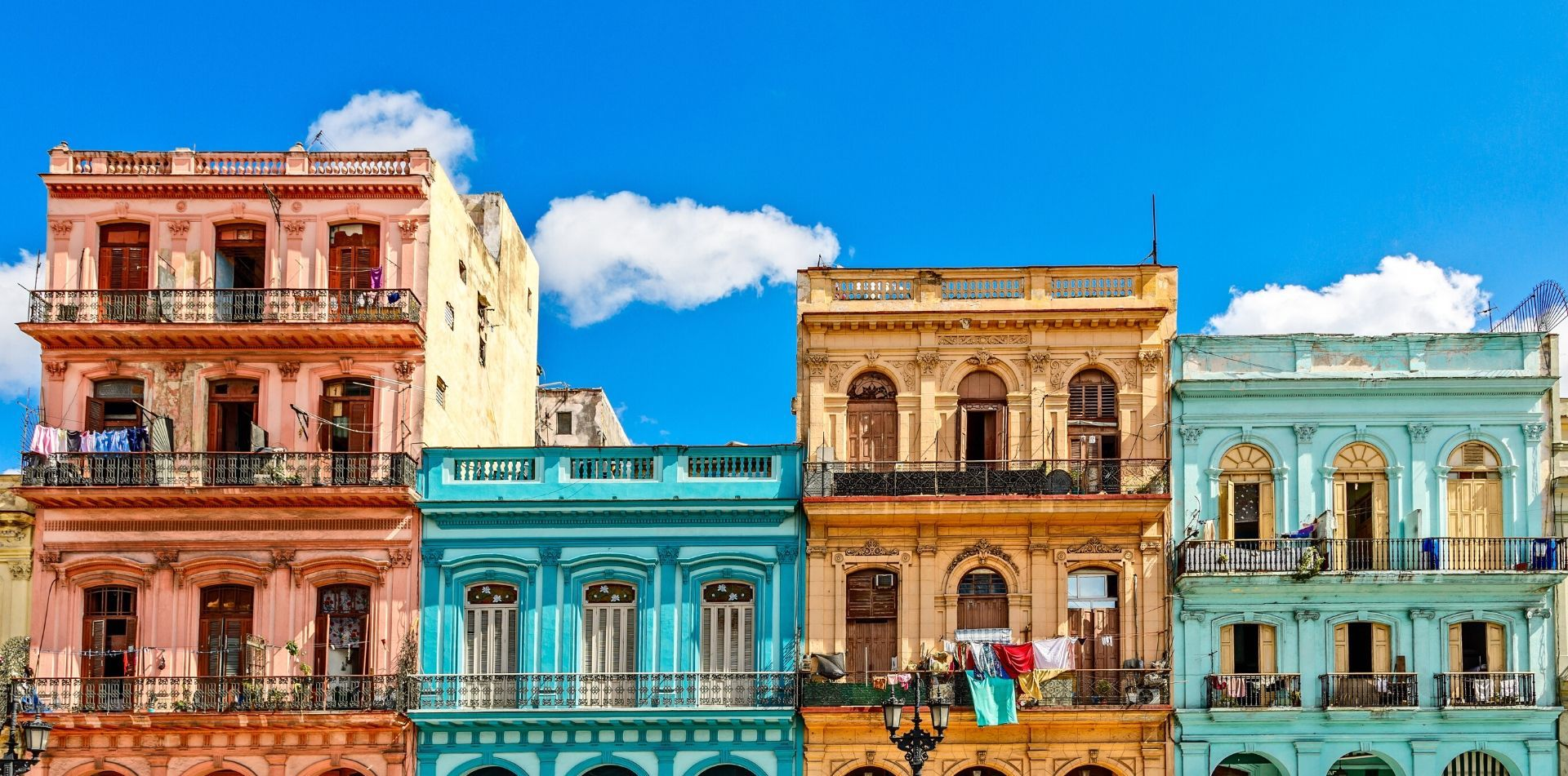 North America Caribbean Cuba Havana old local street beautiful vibrant pastel color buildings - luxury vacation destinations