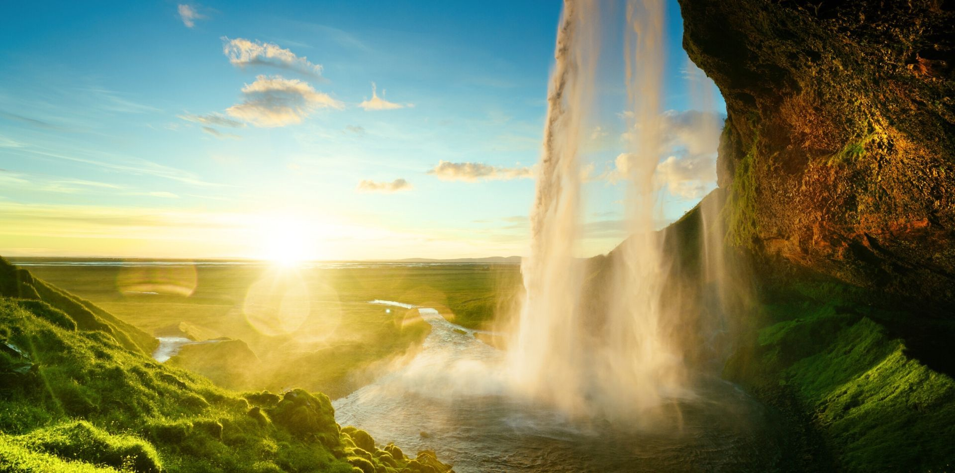 Europe Iceland beautiful Seljalandsfoss waterfall lush mossy rocks bright sunny day - luxury vacation destinations