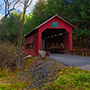 North America United States Vermont historic red Northfield Falls Covered Bidge fall leaves - luxury vacation destinations