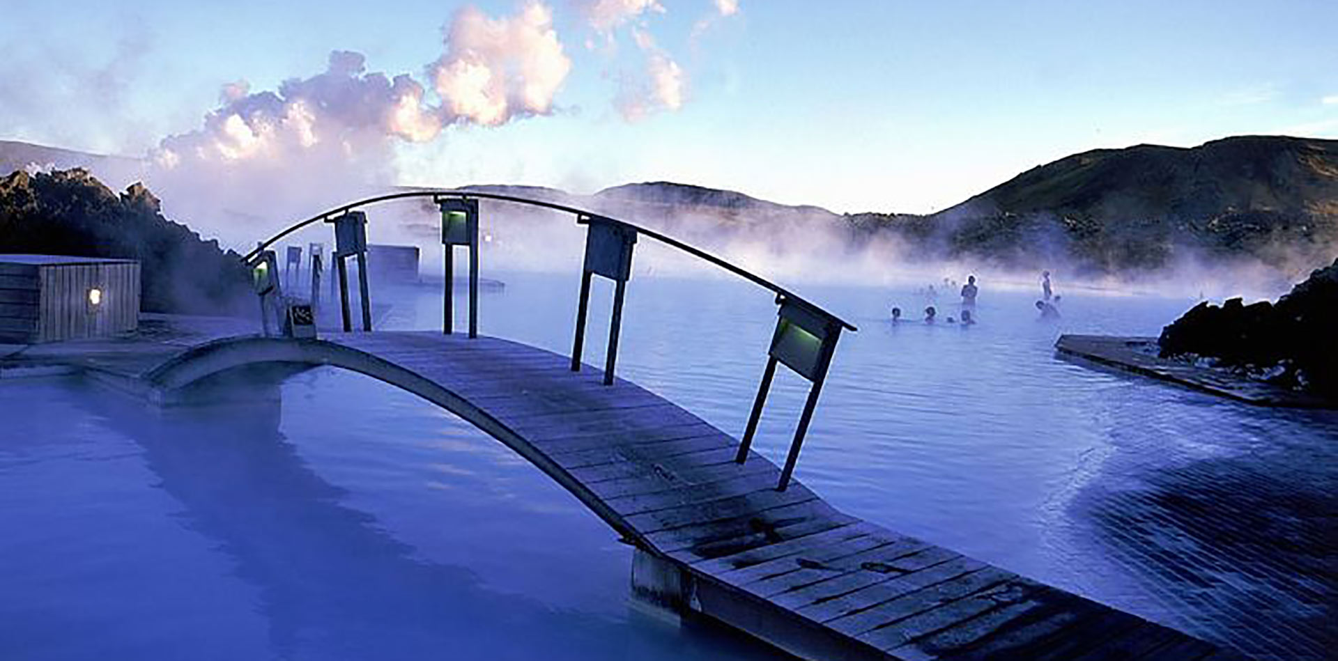 Europe Iceland Blue Lagoon wooden bridge scenic geothermal spa relaxing - luxury vacation destinations