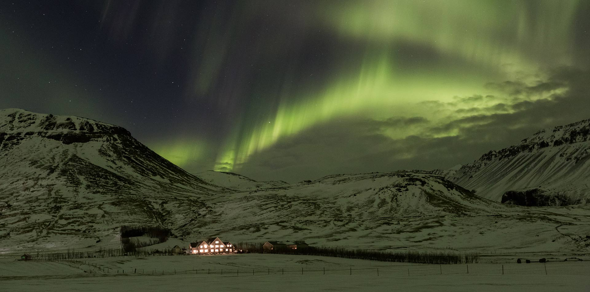 Europe Iceland Hvolsvollur Skalakot Manor Hotel colorful northern lights snow-capped mountains - luxury vacation destinations