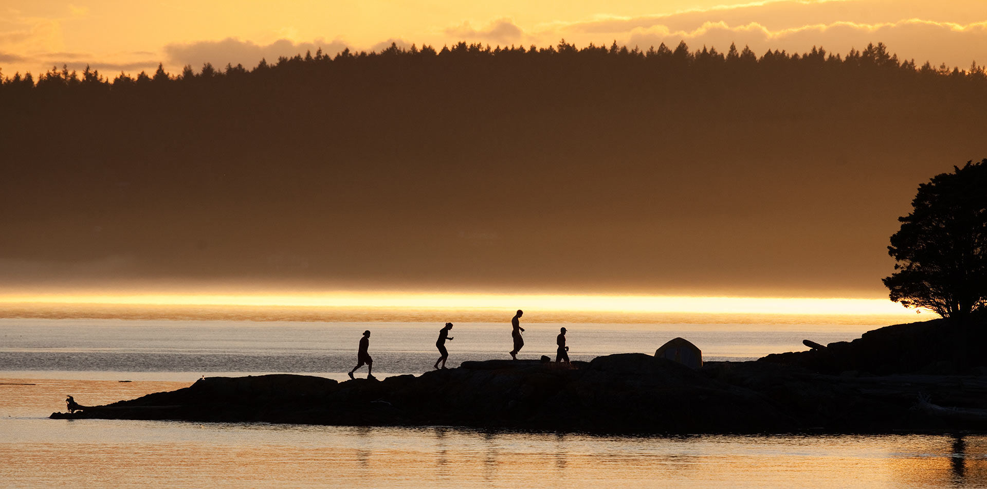 US Pacific Northwest Puget Sound colorful sunset scenic water group hiking rocky shore - luxury vacation destinations