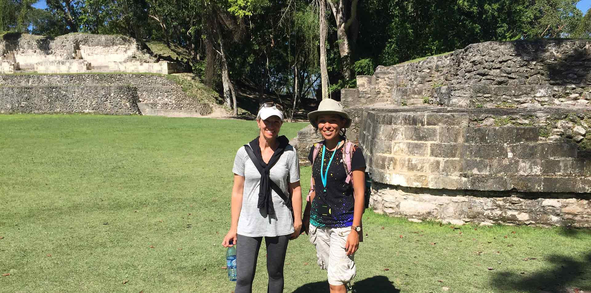 Central America Belize women smiling ancient Mayan ruins historical architecture - luxury vacation destinations
