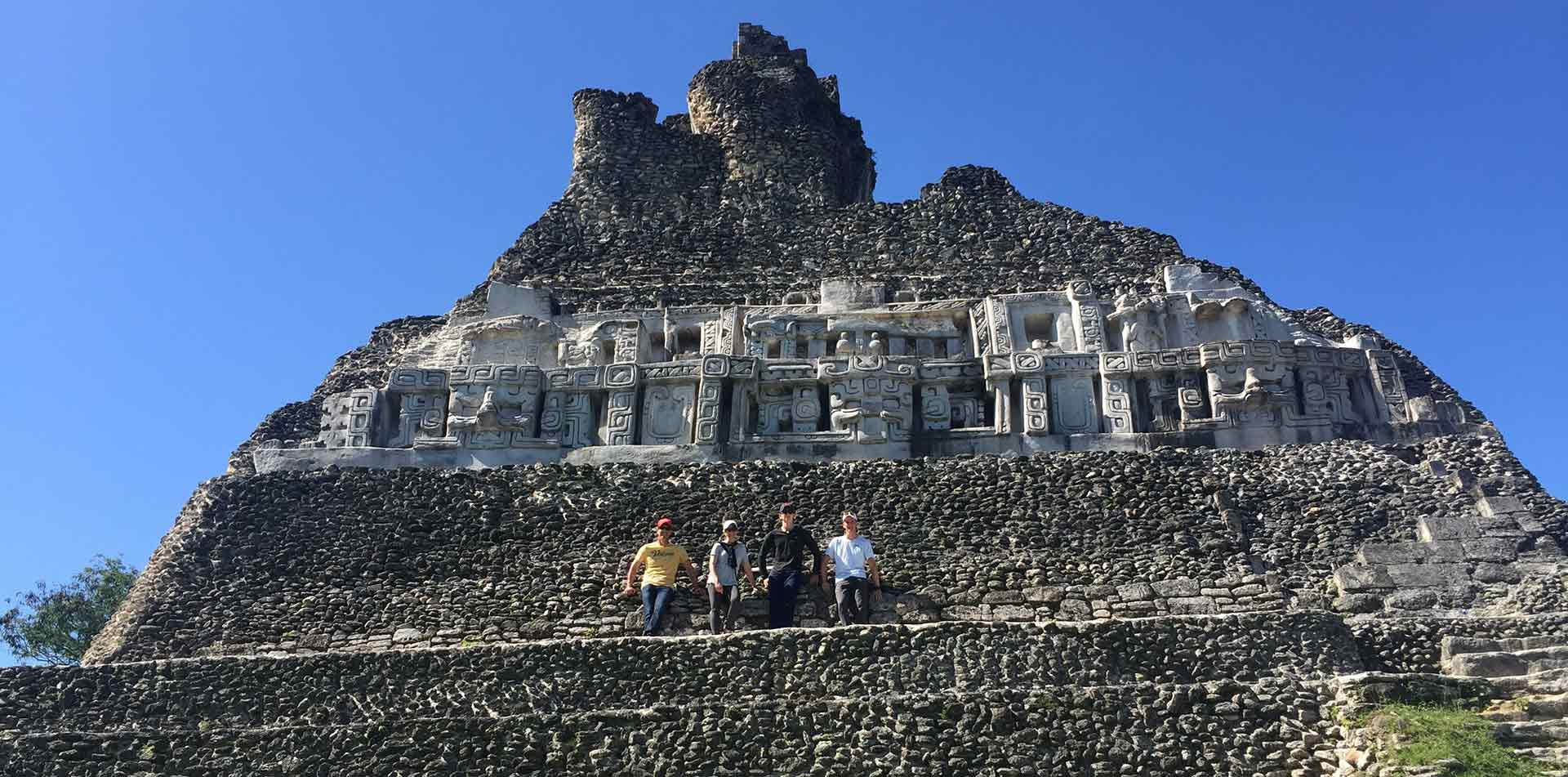 Central America Belize group posing ancient Mayan ruins historical architecture - luxury vacation destinations