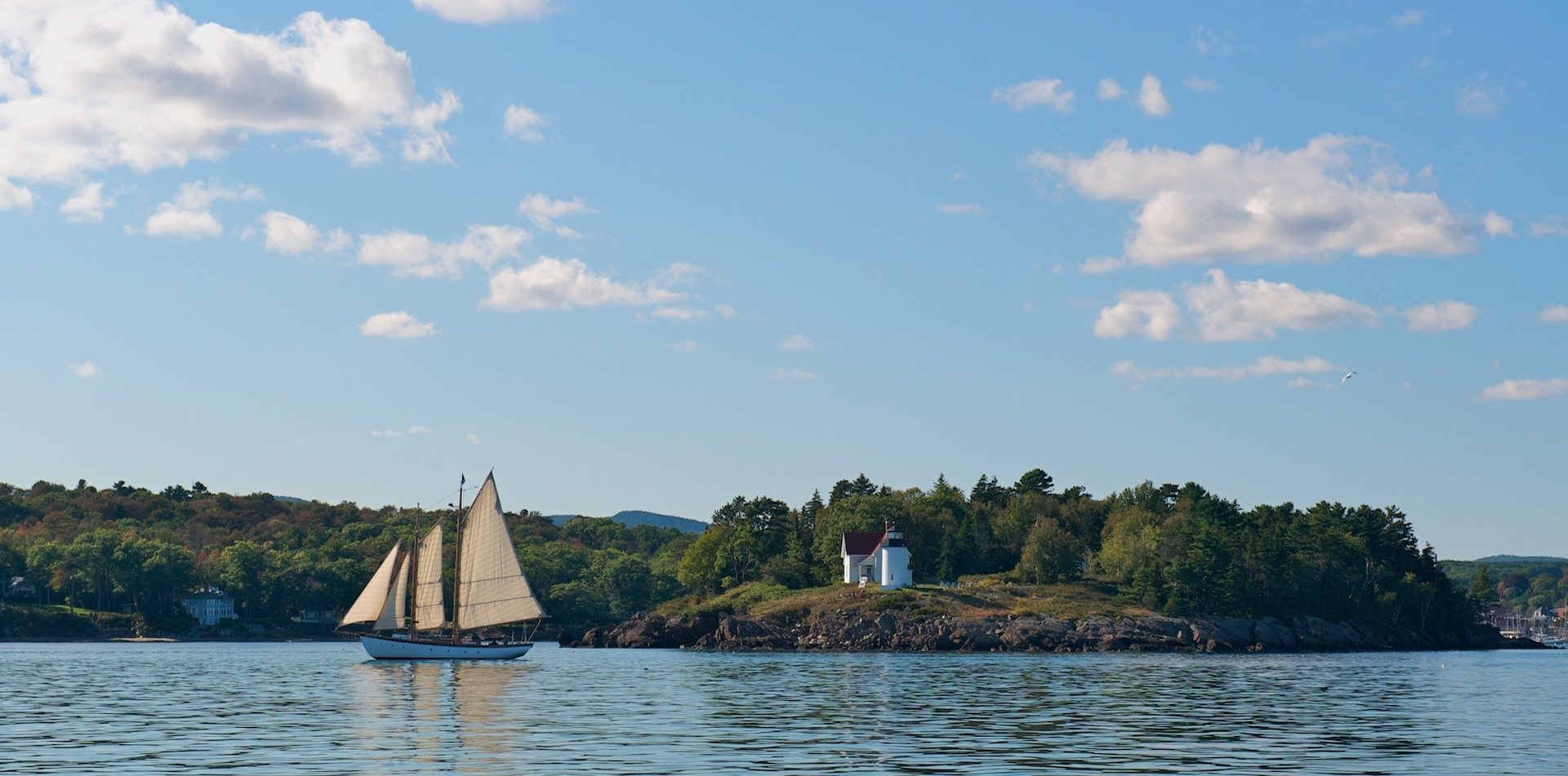 Camden, Maine outer harbor with Curtis lighthouse and sailing ship.jpg