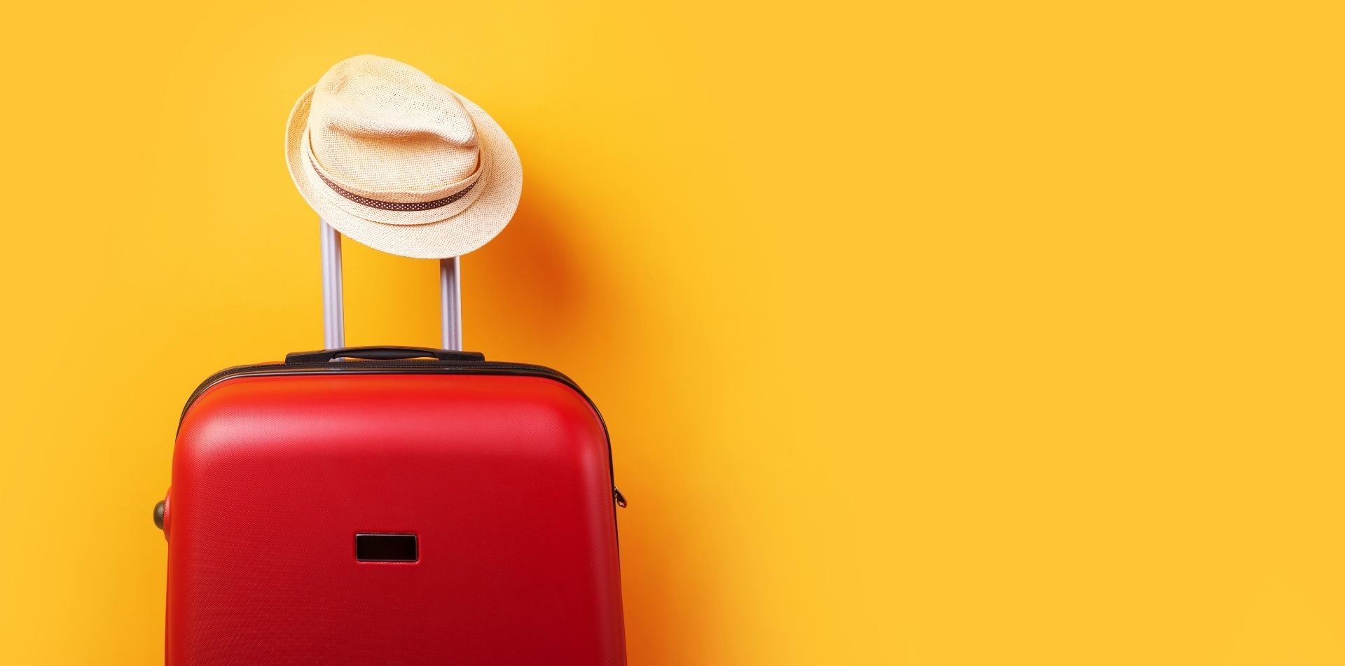 Yellow Background Red Suitcase And Hat