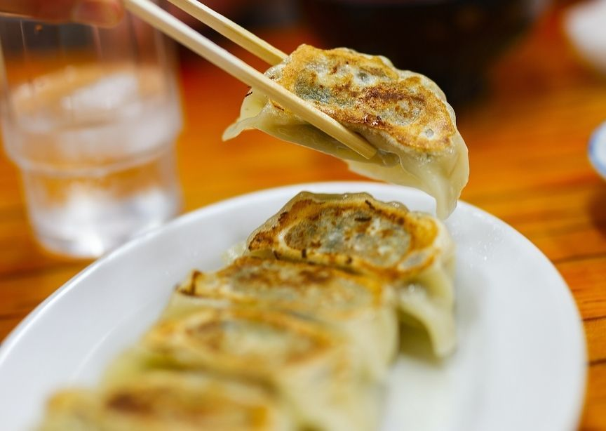 Asia Chinese ear shaped dumplings and chopsticks holiday tradition