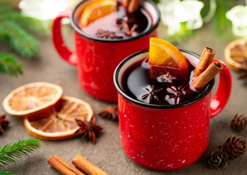 Red tin cup Norwegian Glogg Mulled Wine Winter Cocktail